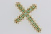 Croix en or sertie d'émeraudes et de brillants. P. 6,3g