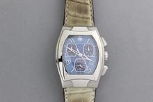 TECHNOMARINE. Magnum. Montre chrono d'homme en acier sur bracelet croco, cadran bleu à trois compteurs.