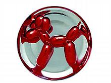 Jeff KOONS, né en 1955   Balloon Dog (red)   Porcelaine finition métal   Editée par le Museum of Contemporary Art, Los Angeles, créée en 1995   Edition limitée, numérotée 2114/2300, datée et signée   Diamètre : 26,5 cm