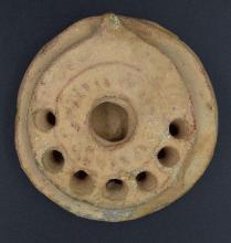 A rare Byzantine terracotta oil lamp
