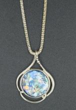A Roman glass fragment in silver trefoil pendant
