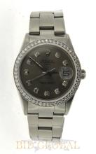Men's Polished Stainless Steel Diamond Rolex Date. Appraisal Value: $14,000