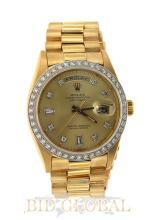 Gold Rolex Day Date with Custom Diamond Bezel. Appraisal Value: $44,000