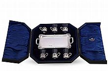 A SET OF SIX PEG GLASSES WITH SILVER TRAY