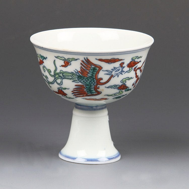 A Chinese porcelain stem cup with pale celadon