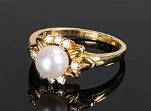 18 carat gold, pearl and diamond set ring, the cen