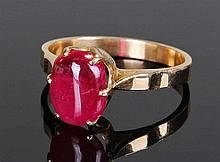 18 carat gold and simulated ruby set ring. The cen