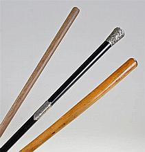 Three conductor's batons. The first an ebonised ex
