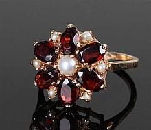 9 carat gold garnet and pearl ring, set to form a