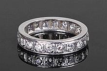 Diamond eternity ring, the white metal diamond set