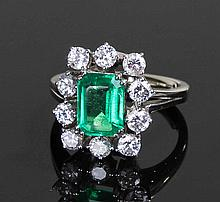 Fine Colombian emerald and diamond set ring, the c