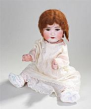 A Heubach porcelain headed doll, model number 300.