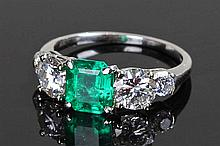 Platinum emerald and diamond set ring, the central