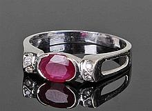 18 carat white gold ruby and diamond ring, the cen