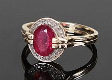 9 carat gold ruby and diamond ring, the central ru