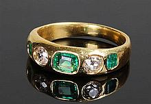 Emerald and diamond set ring, the central emerald