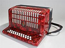 Galotta two row melodeon in a red pearl effect fin