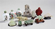 A group of Oriental carved figures including a soa