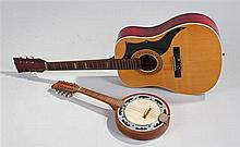 Mandolin banjo, together with an acoustic guitar (