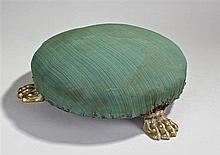 Brass footed footstool. The pad top above three li
