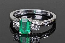 18 carat white gold emerald and diamond set ring.
