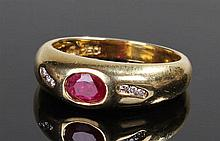 Ruby and diamond ring, the oval faceted ruby in a