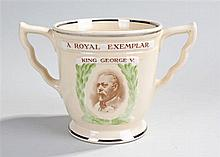 Royal Doulton twin handled cup commemorating the d