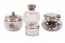 LOT OF FOUR STERLING TOPPED DRESSER JARS