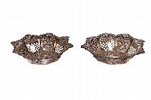 TWO STERLING REPOUSSE NUT DISHES