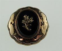 Brosche -19. Jh. - ovale Onyxplatte mit floralem Motiv(besetzt mit 3 kl. Pe