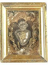 Votivgabe/Klosterarbeit - hinter Glas im Goldrahmen, mittig das flammende H