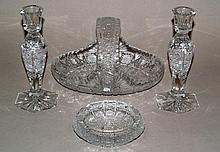 Convolute crystal glass consisting of bowl with handle, few candlesticks and ashtrays;