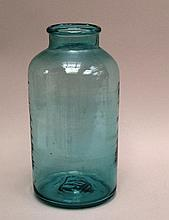 Storage jar- 1900, light green cylindrical glass body with retracted shoulder,