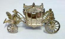 A Miniature Sterling Silver Coronation Carriage.