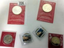 A qty of 6 silver coins.