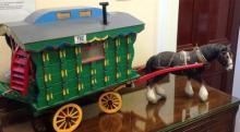 A Hand made Wooden model Gypsy Caravan with pottery shire horse.