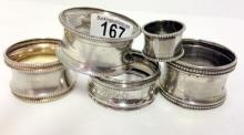 5 Antique continental solid silver napkin rings.