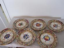 Set of 12 Capodimonte pictorial plates. 8.5