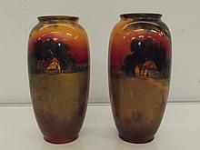 Pair of Royal Doulton vases with farmland and cottage scene. Signed H Motte