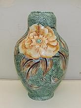 A large Royal Couldon vase, green with flower scene. 33cm high.