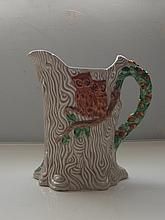 Clarice Cliff, Newport Pottery water jug, bark design, depicting two perche