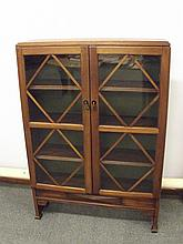 Art Deco freestanding mahogany bookcase, two glazed doors enclosing four sh