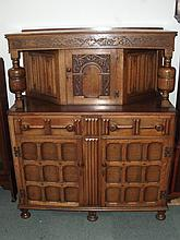 Good quality oak reproduction court cupboard, fruit and leaf carved frieze,