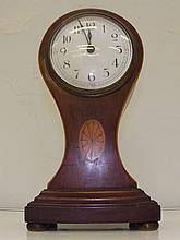 An Edwardian inlaid mahogany balloon mantle clock 24cm high.