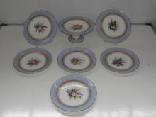 Royal Worcester dated 1879 6 plates and a comport. Hand painted with a purple stamp on the bottom.