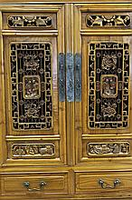[CHINESE]A LATE 19TH CENTURY NANMU WOOD CABINET CARVED WITH FIGURES AND BATS L:33