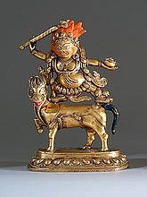 [CHINESE]A LATET 19TH CENTURY SINO-TIBETAN GILT-BRONZE FIGURE Depicting Mahakala wearing a skull apron while dancing on a horse. Height 7.5