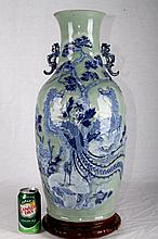 [CHINESE] EARLY 19TH CENTURY PEA GREEN GLAZED BASE WITH BLUE AND WHITE PORCELAIN VASE WITH HANDLE PAINTED WITH PHOENIX AND FLOWERS (ONE OF THE HANDLE HAS RESTORED) W:9