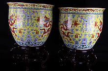 [CHINESE]A PAIR OF  YELLOW GLAZED BASED WITH FAMILLE ROSE PORCELAIN TANKS PAINTED WITH DRAGONS, WAVES, AND CHINESE CHARACTER