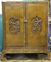 [CHINESE]A LATE 19TH CENTURY NANMU WOOD CABINET CARVED WITH FIGURES L:35